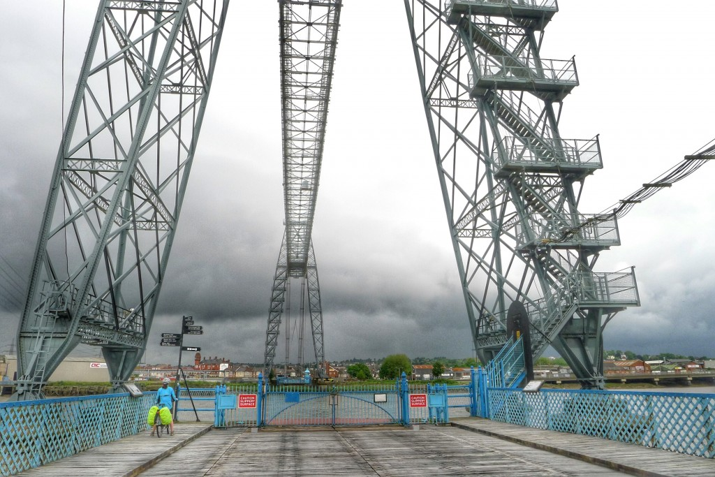 "Carrie and I arrived at the transporter bridge unsure what to do. We expected to see a regular bridge. The bridge ""driver"" set us straight."
