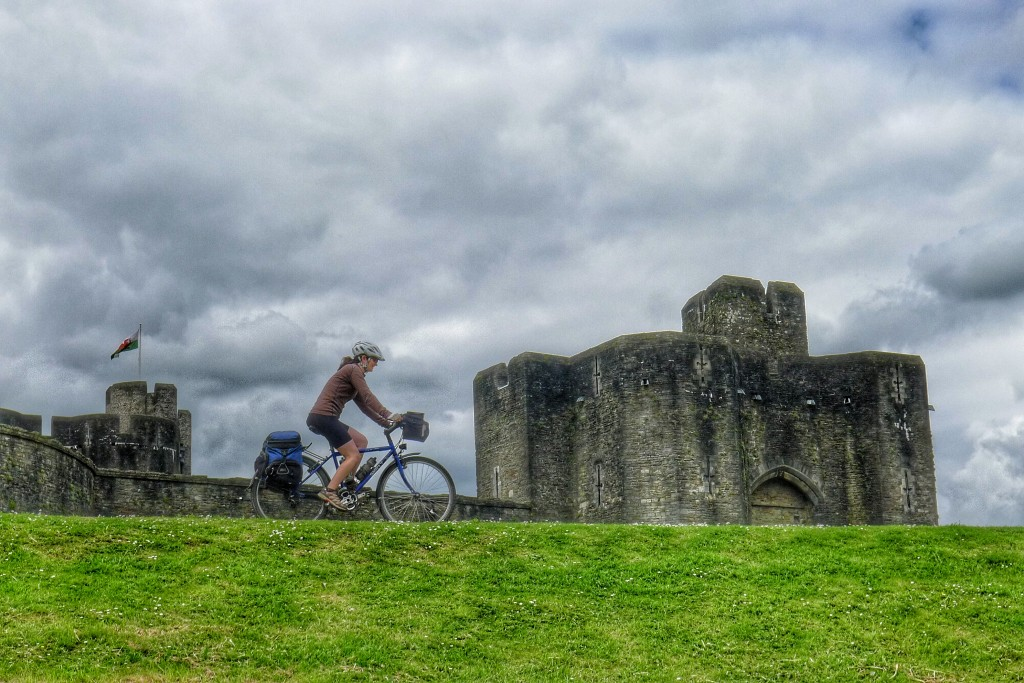 Carrie rides along the levee of the outer moat of the Caerphilly Castle.