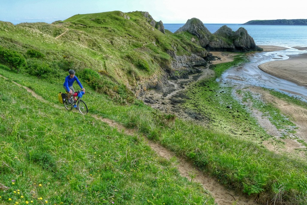 I tried to ride small portions of the sand dunes above Three Cliffs Bay.