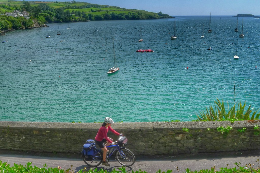 Carrie rides by the harbor of Glandore.