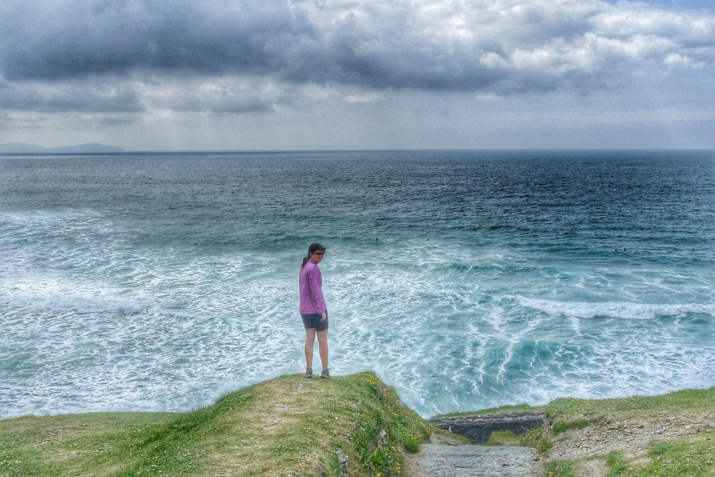 Carrie stands before the vast Atlantic on a cliff along the Dingle Peninsula.