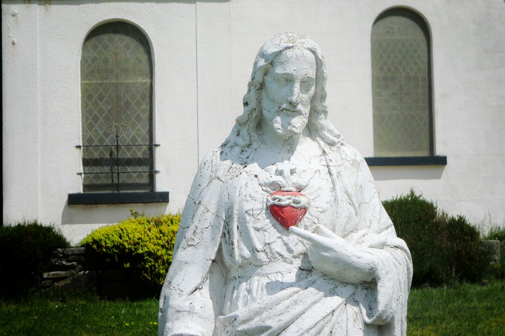Jesus resides outside a church in rural County Mayo.