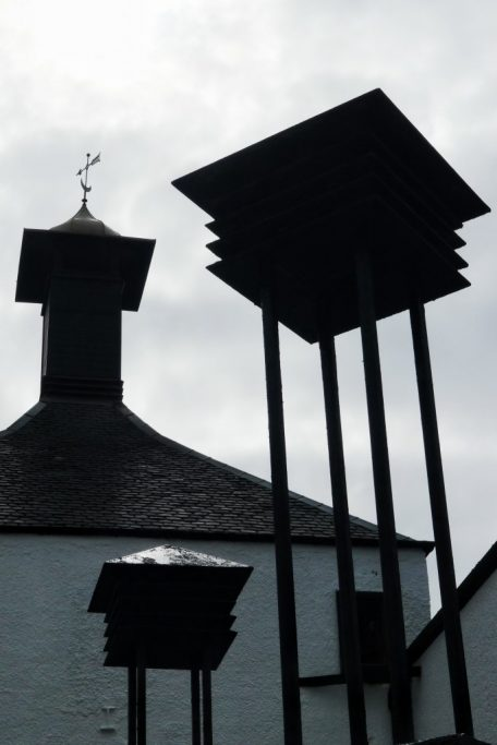 The pagoda at the top of the Bowmore distillery helps direct the peat smoke through the drying barley to infuse the peat and smoke flavor.