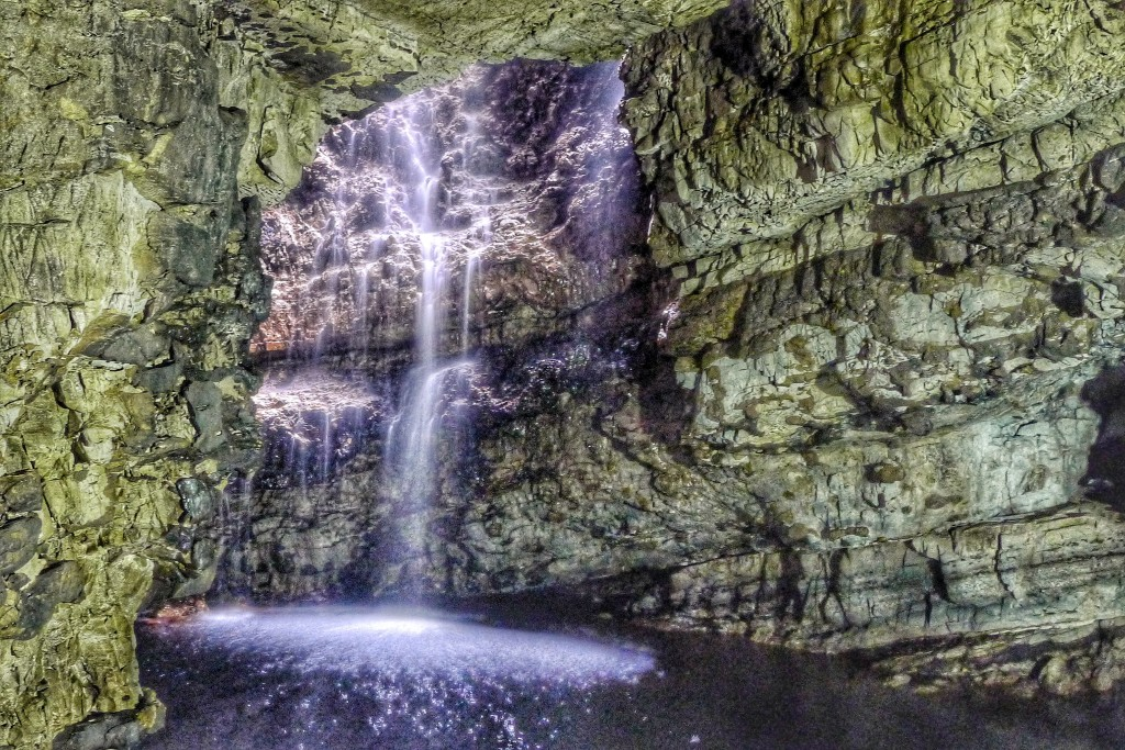 This waterfall I'd helping enlarge a blowhole inside the Smoo Cave. The colors are strange because the camera was tricked the fluorescent and natural light sources.