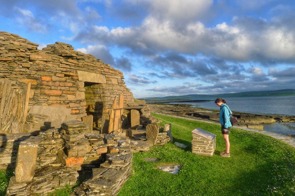 Carrie reads up on the Midhowe Broch. Brochs are circular buildings built about three thousand years ago. Experts cannot agree on what the brochs were used for. Regardless, they're fun to walk around to admire ancient architecture.