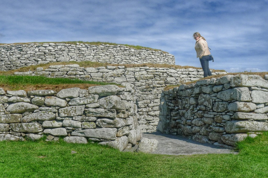 A woman takes a gander at the impressive broch in Lerwick.