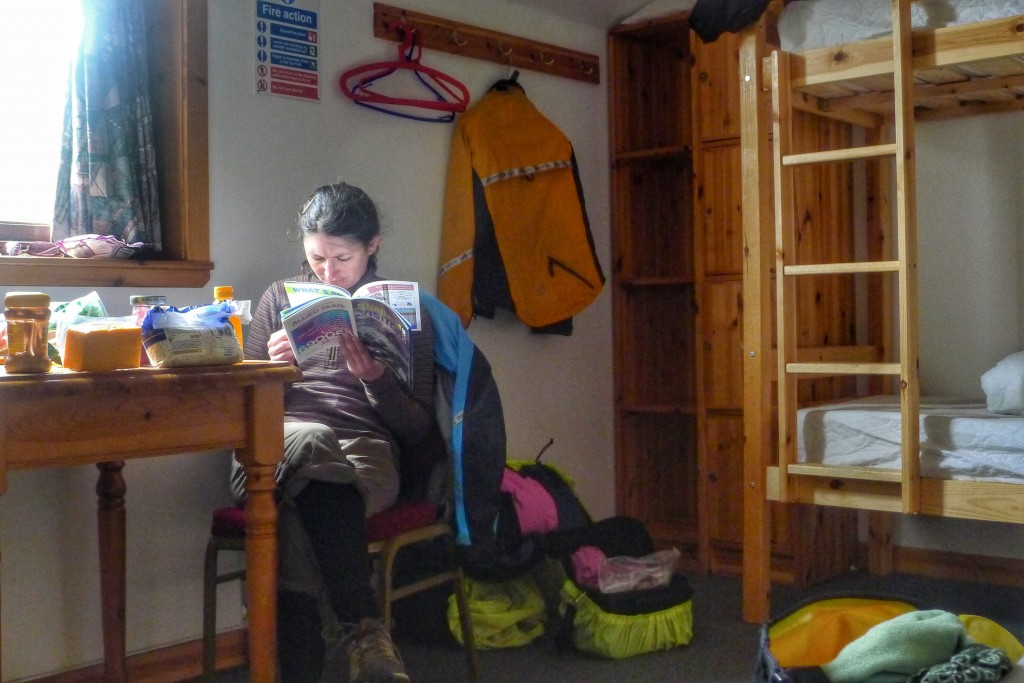 Carrie does some reading in the hostel in Lerwick. It felt so luxurious to be indoors.
