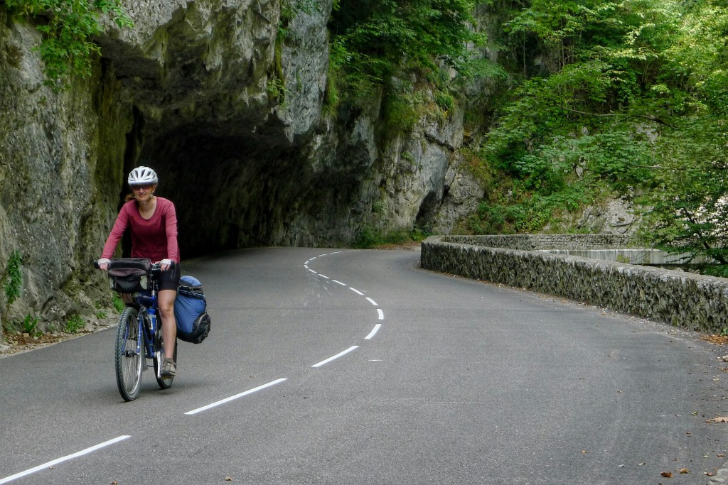 Carrie rides down the Gorges de la Bourne, a road carved into the cliff along the Bourne River
