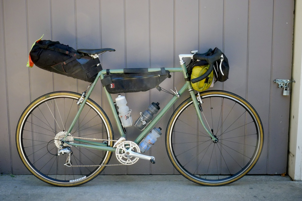 My homemade frame Green Machine sports a set of bikepacking bags and a random assortment of parts. Green Machine is a true frankenbike.