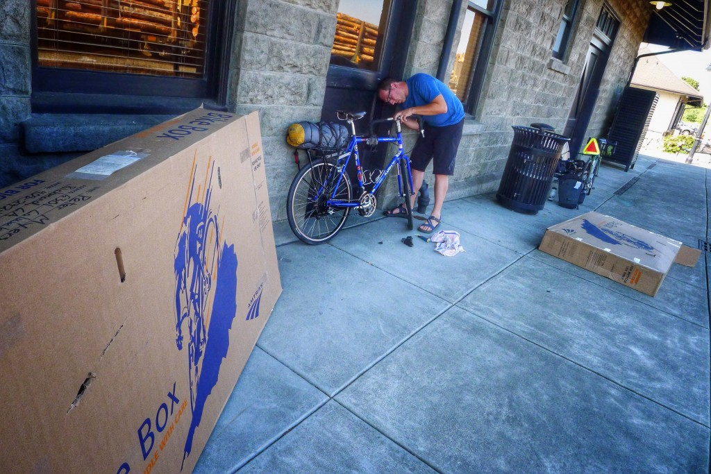 Peter gets his handlebars dialed in. The bike boxes are massive.