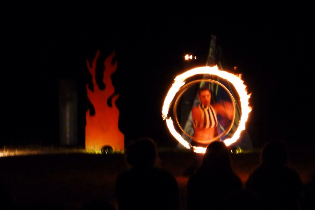A performer uses a burning hula hoop to wow the crowd of campers at the Elk Country RV Park.