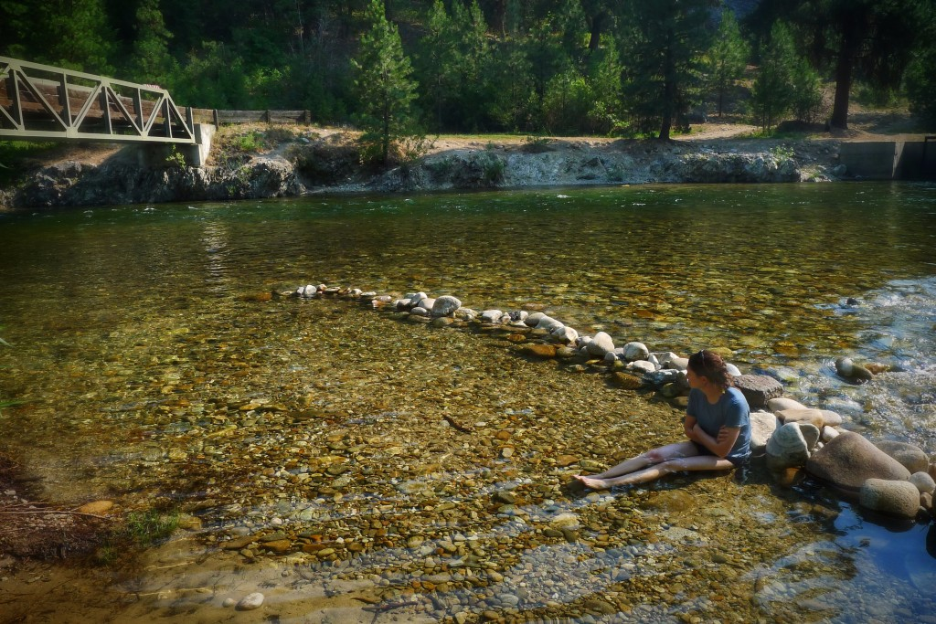Carrie chills in the river at the Abbot campground in an effort to keep the swelling in her knee to a minimum.